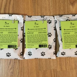 three white bags of premium dog treat